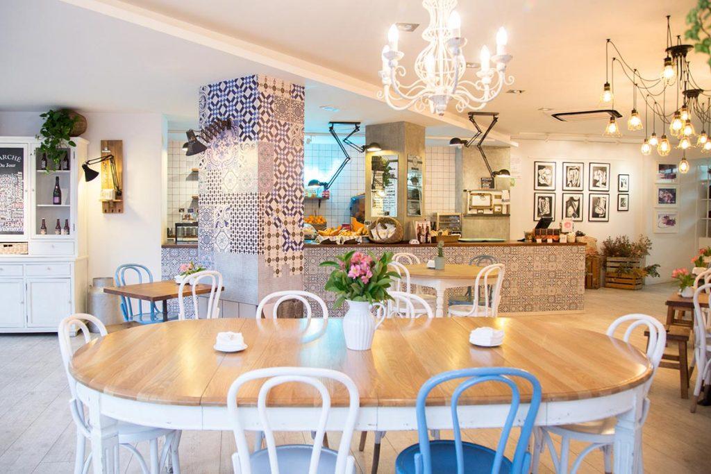Revestimientos fs manises en el dise o interior de tartela for Decoracion cafeterias modernas