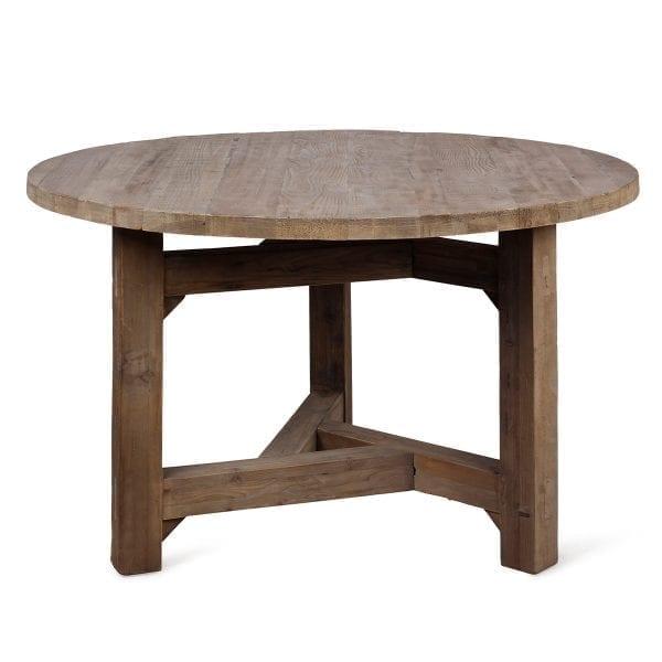 Mesa redonda de estilo rústico.