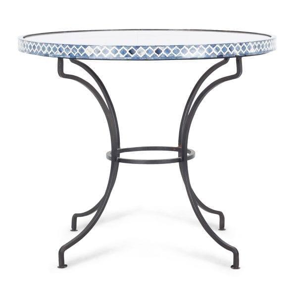 Mesa redonda con sobre de mármol.