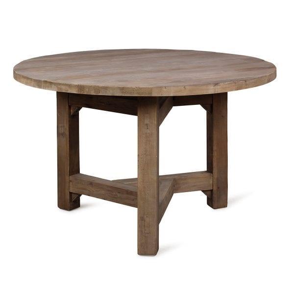 Table ronde en bois de brasserie.