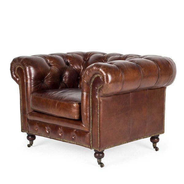Individual armchair in brown leather.